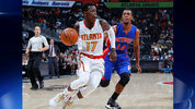 Dennis Schroder #17 of the Atlanta Hawks drives against Ish Smith #14 of the Detroit Pistons at Philips Arena on October 13, 2016 in Atlanta, Georgia. (Photo by Kevin C. Cox/Getty Images)