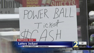 Crowds try their luck at massive $700M jackpot