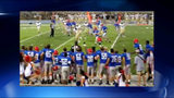 High school senior with down syndrome scores touch down during football game