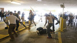A Marietta man accused of beating a protestor in Charlottesville turned himself in.