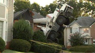 Crane tips over, splits family's home in half | WSB-TV