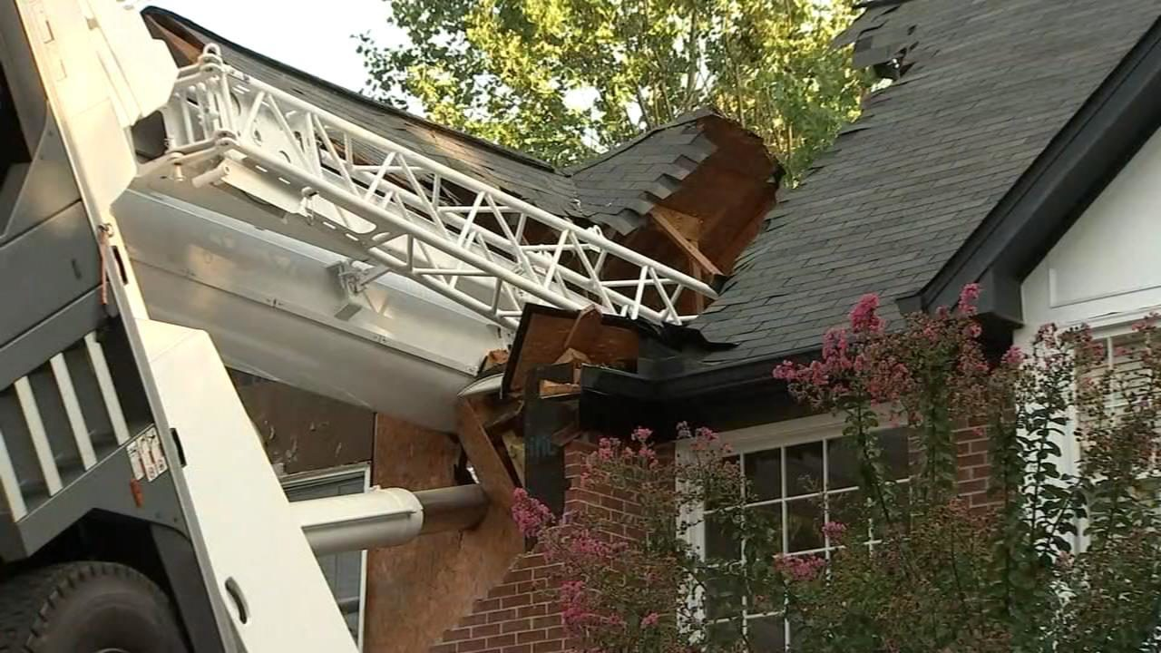 Crane tips over, splits family's home in half | WSB-TV