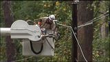 A Georgia Power lineman works to restore power after a storm.