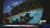 Couple crashes car into hotel swimming pool