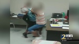 Teacher is repeatedly slapped during fight between students