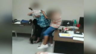 VIDEO: Teacher is repeatedly slapped during fight between students
