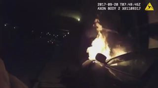 VIDEO: Officers hailed as heroes for rescuing people trapped inside burning car