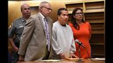 Lishan Wang, center, appears in court with Chief Public Defender Thomas Ullmann, left, during his sentencing at New Haven Superior Court Friday, Sept. 22, 2017, in New Haven, Connecticut.