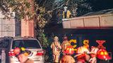 Train derails, hitting house; 1 hospitalized.