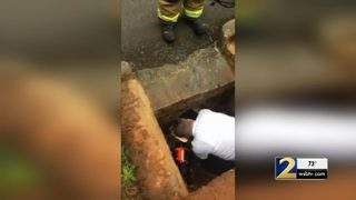 Forsyth County firefighters rescue dog from storm drain