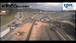 Lanes re-open on I-20E after tractor trailer spill