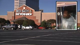 Woman leaving work carjacked at gunpoint in busy shopping center