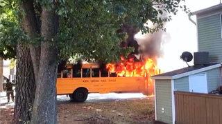 16 high school students, driver escape school bus fire