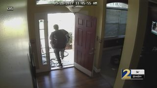 Home surveillance cameras catch burglar in the act moments after family leaves