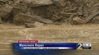 Broken water main crumbles road, leaves schools without water
