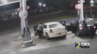 Video shows men snatch woman out of car before carjacking her vehicle