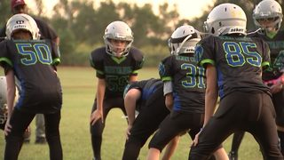Doctor says letting kids play football should be considered child abuse