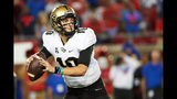 McKenzie Milton #10 of the UCF Knights throws an 80 yard touchdown pass against the SMU Mustangs during the first half at Gerald J. Ford Stadium on November 4, 2017 in Dallas, Texas.