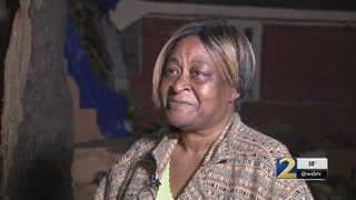 Woman says she left bedroom just seconds before tree came crashing in