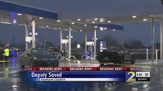 Bystander shoots at man allegedly attacking deputy outside gas station