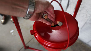 Another gold coin worth $1.2K left in Salvation Army Red Kettle