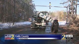 GDOT crews work to restore power, clean debris from snow storm