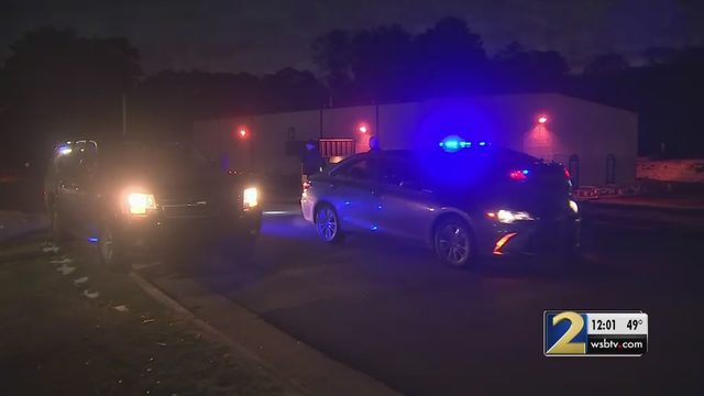 Police searching for two men they say shot at officer in Cobb County