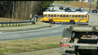 2 injured, including child, in crash involving school bus in Hall County