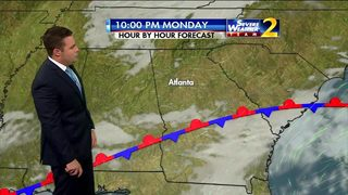 Mostly cloudy skies Monday morning