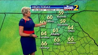 Mostly cloudy, temperatures in upper 50s Monday afternoon