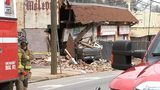 A vacant building in Midtown collapsed after a car crashed into it Tuesday afternoon, Atlanta fire officials said.