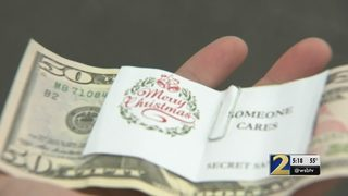 Covington police hand out $50 bills to community members