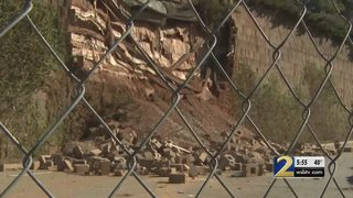 Collapsed retaining wall at shopping center puts people in danger, customers say