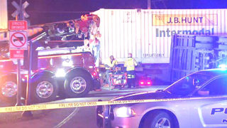 Train hits semitruck in Gwinnett County, splitting it in two