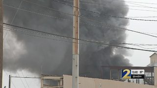 Crews put out 4-alarm fire at plant near airport
