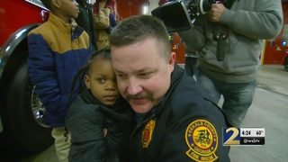 Firefighter reunited with child thrown from apartment during raging fire
