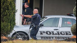 Police respond to call about armed man at Henry County hotel.