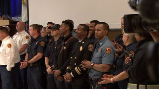 County honors hero firefighters who rescued families from apartment fire
