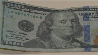 Thousands of dollars in phony bills passed off as real, police say