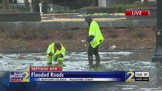 Clogged storm drains floods busy roads
