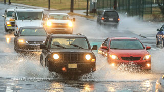 Clogged storm drains cause metro roads to flood