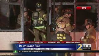Fire destroys newly-opened restaurant