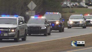 Dozens escort body of fallen Locust Grove officer to funeral home