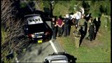 RAW VIDEO: Police place alleged shooter into back of ambulance