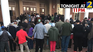 Community holds prayer vigil opposing new city proposal