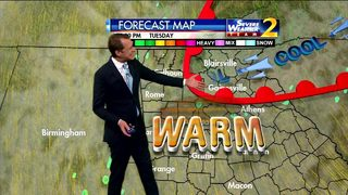 Mostly cloudy, warm early Tuesday evening