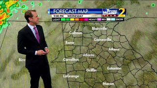 Few isolated showers possible, warm temperatures early Wednesday evening