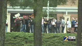 Local students join nationwide protests calling for change in gun laws