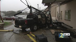 Thousands of dollars in damage after car plows into trucking company