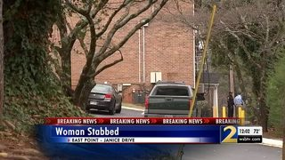 Woman found stabbed to death behind dumpster